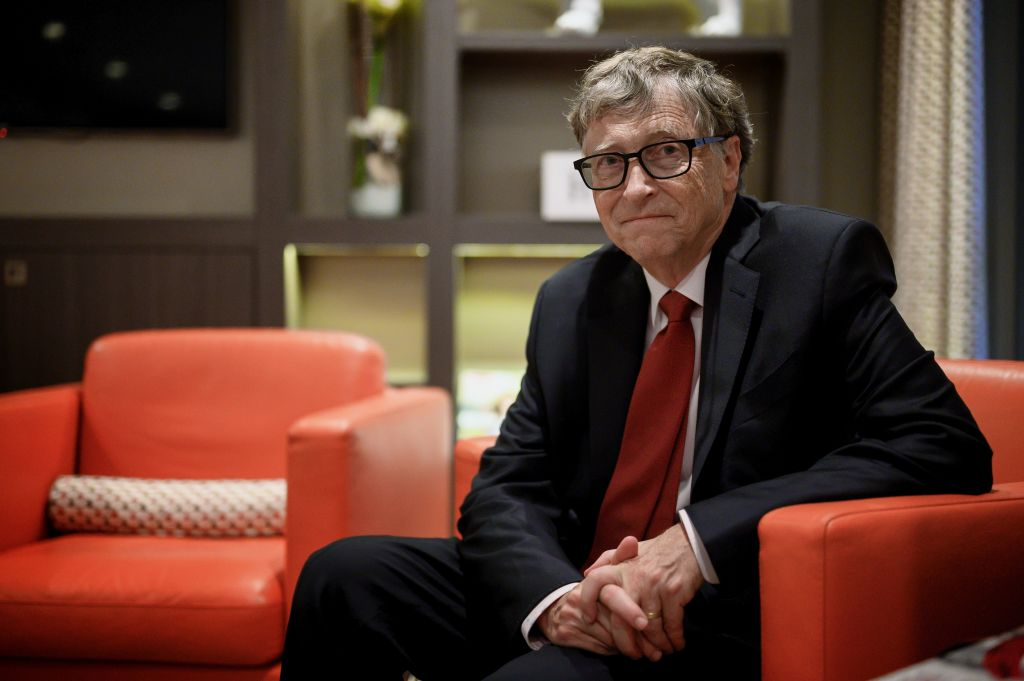 Bill Gates sitting in a chair