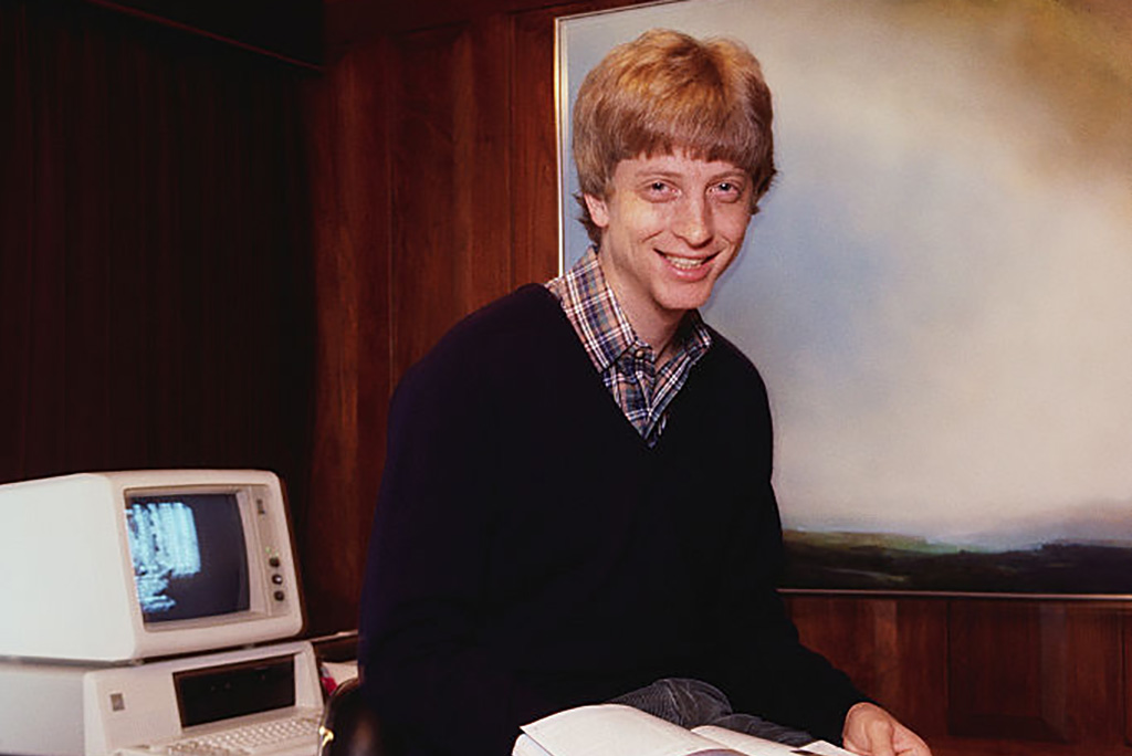 Bill Gates posing by computer