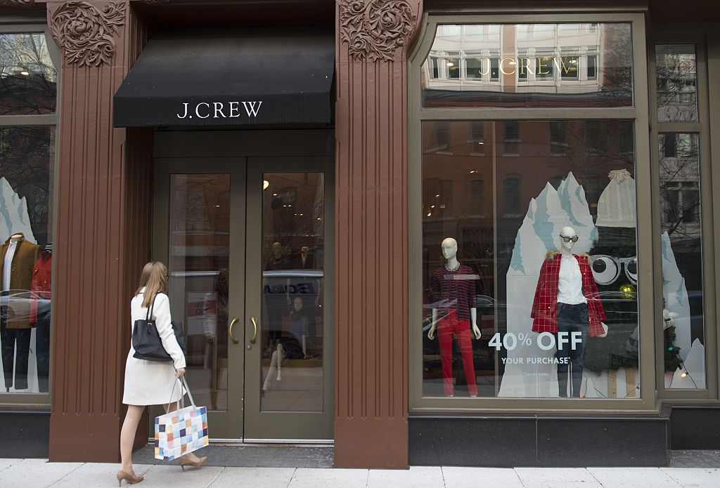 A woman walks into a J.Crew store.