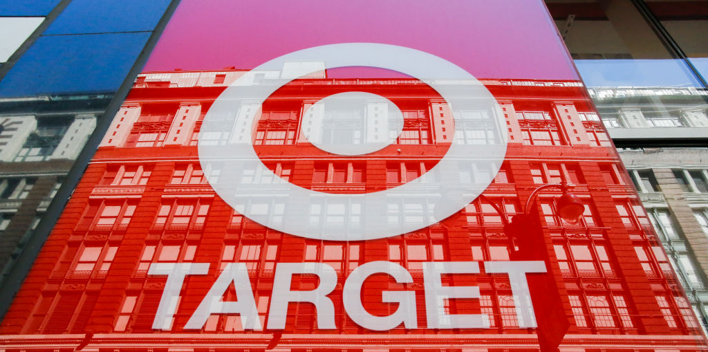 The reflection of a building is apparent in a glass Target store sign.