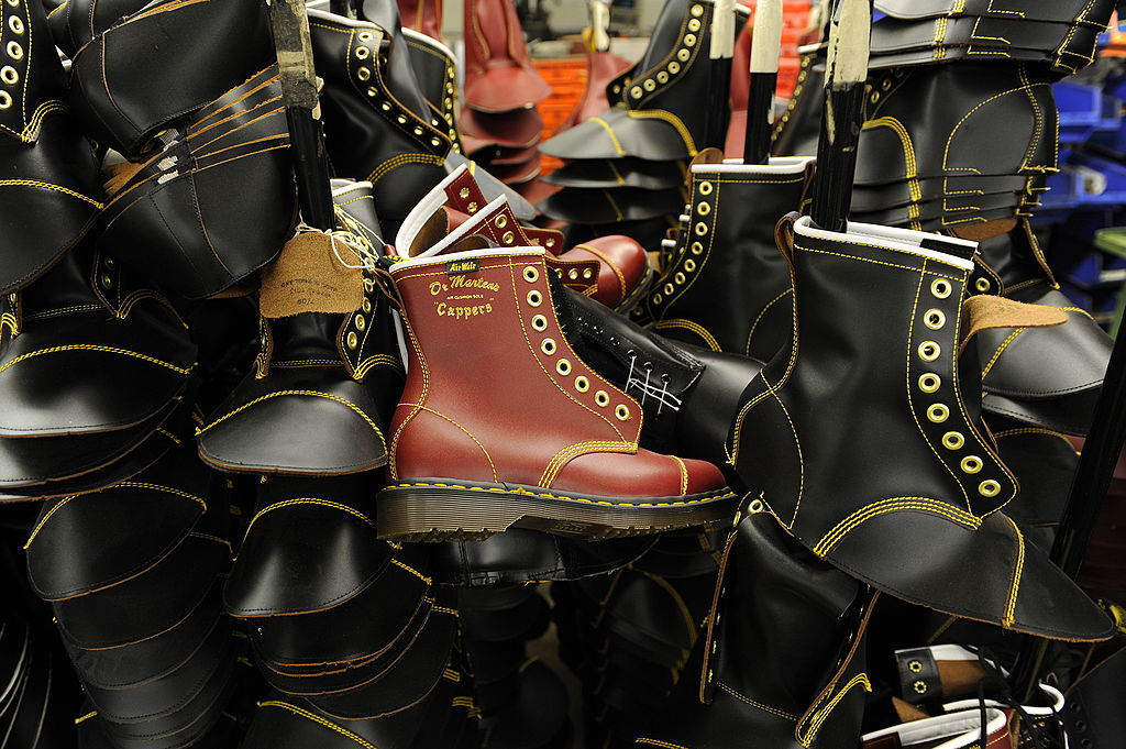 A photo reveals a pile of Dr. Martens shoes.