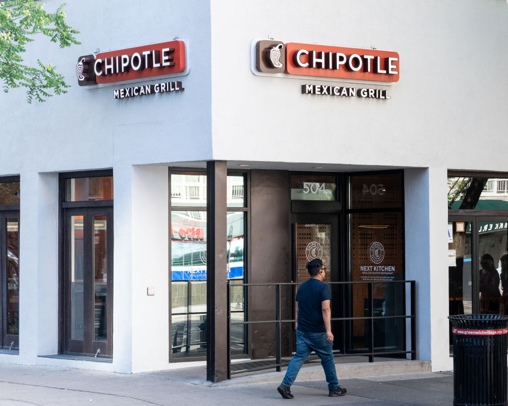 A man walks past Chipotle.