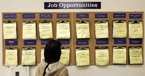 A job seeker looks at a job listing board