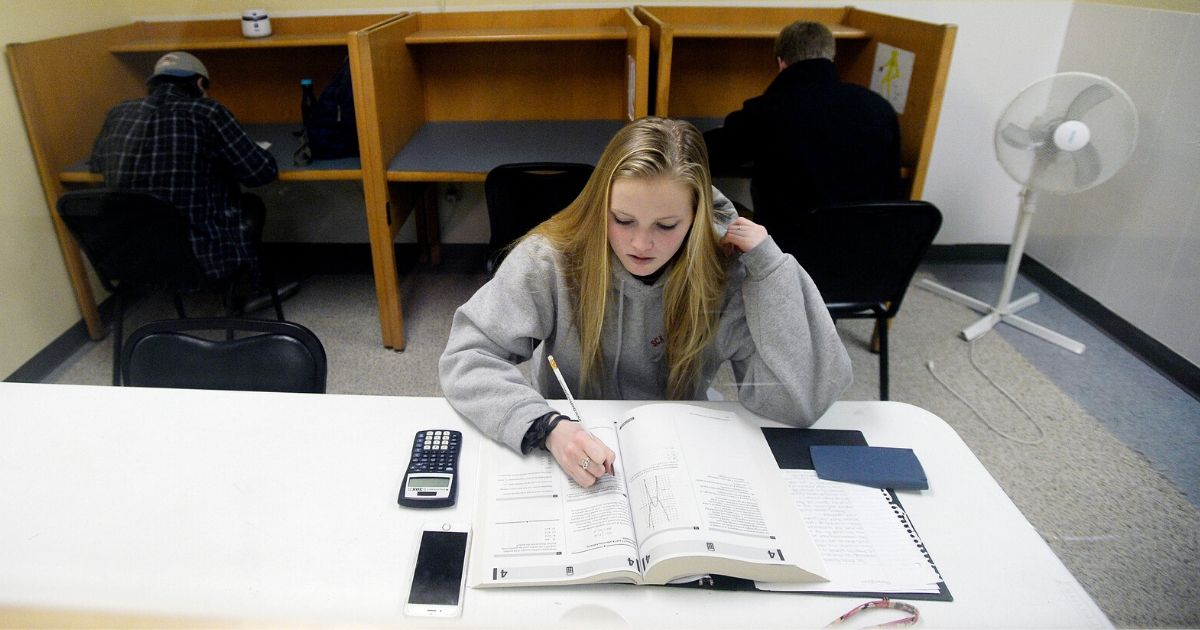 A teen takes a pre SAT Test in a room with other students at The Study Hall