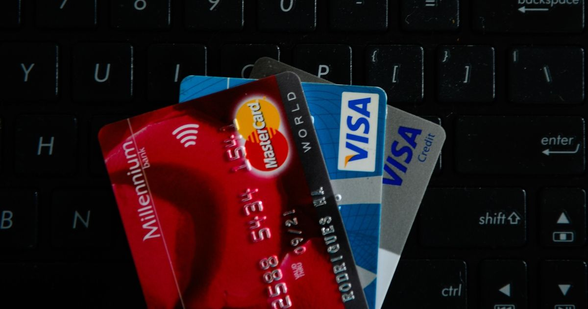 VISA and Mastercards credit cards are seen on the top of a laptop keyboard