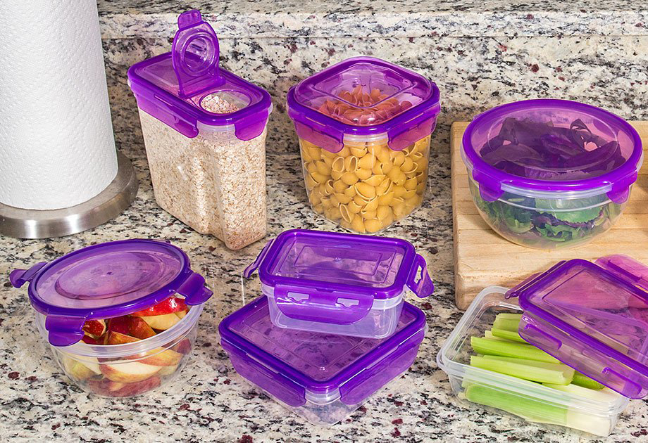 Purple-lidded food containers from Dollar Tree store food on a kitchen counter.