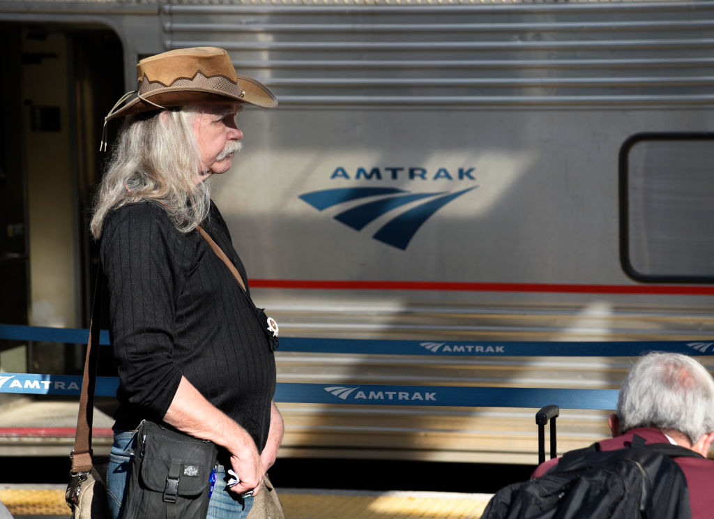 A passenger waits in line prior to boarding an Amtrak