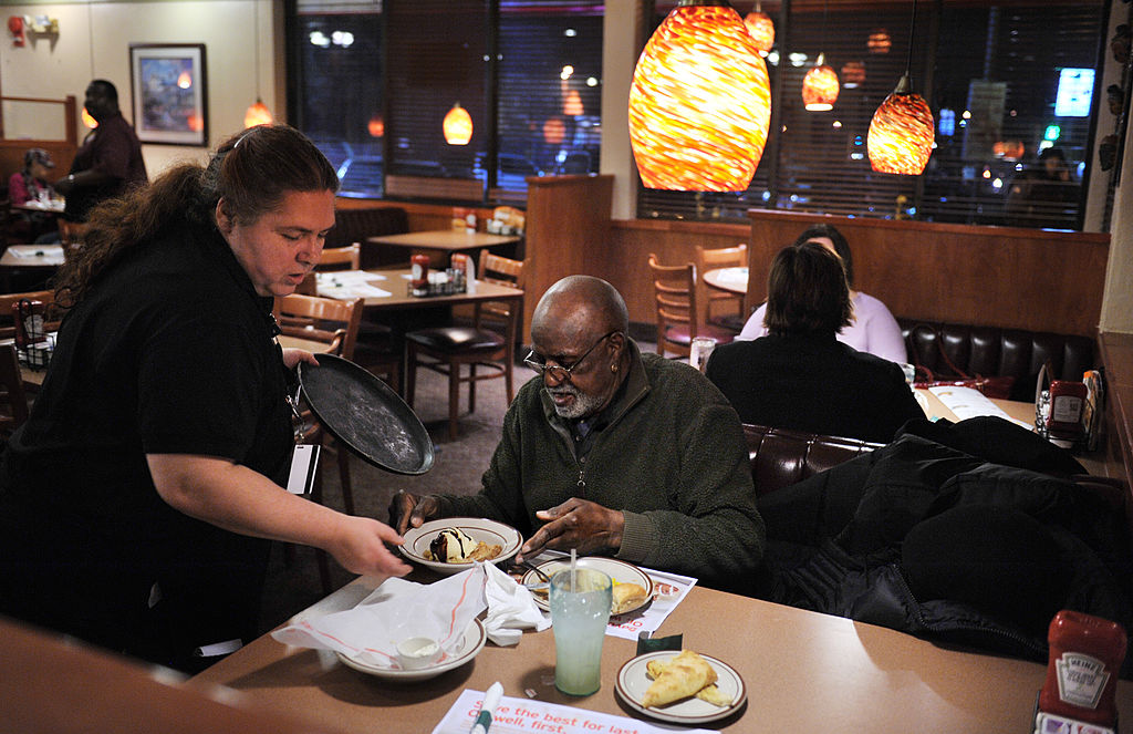 Wanda Nazir serves after-dinner dessert to Benjamin Bennaugh, 76, at Denny's