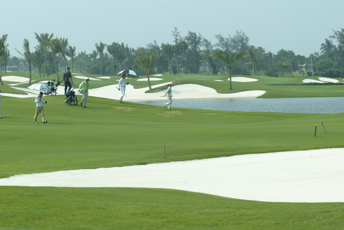Golfers walk through a course in Hainan.