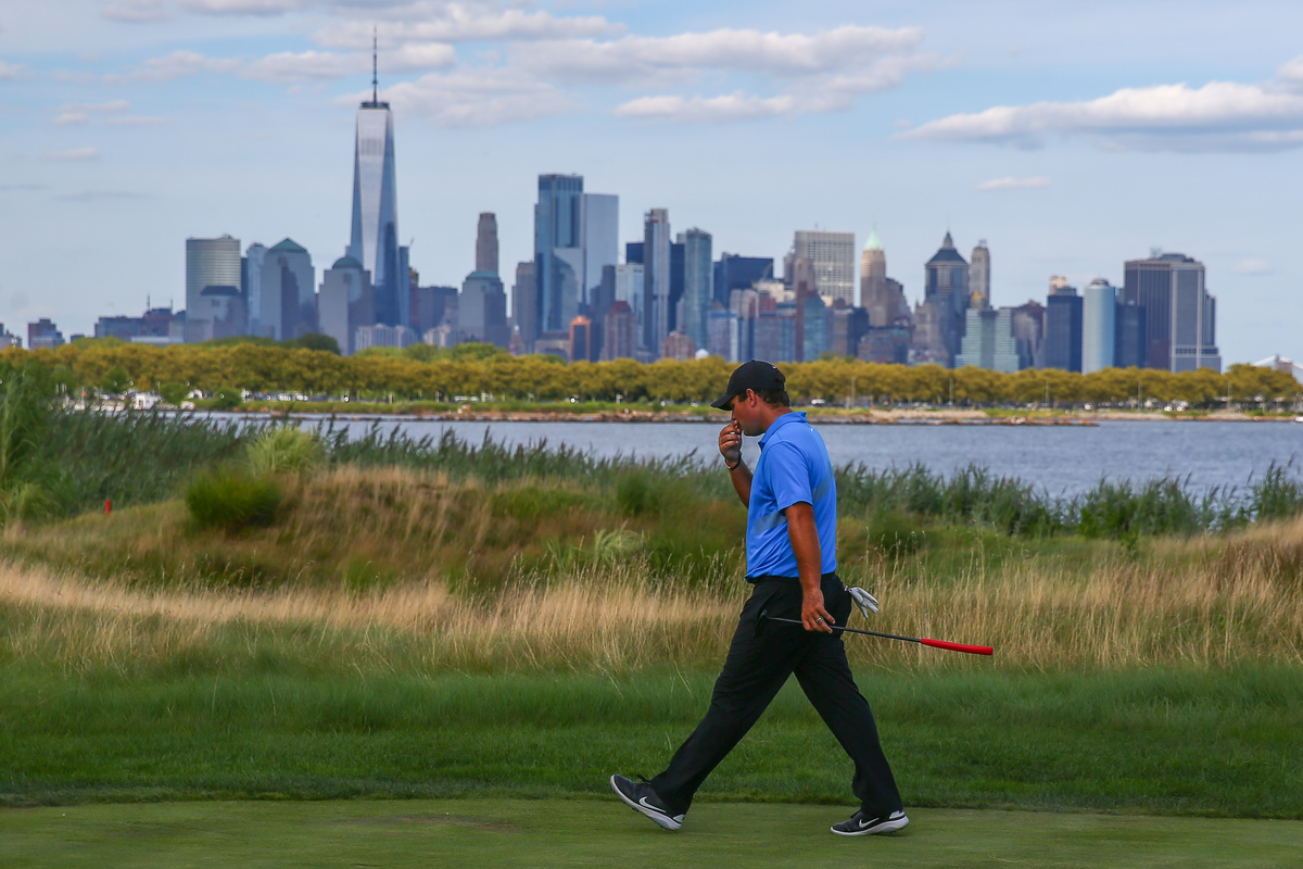 Patrick Reed walks down the 14th fairway at Liberty National Golf Club in Jersey City, NJ.