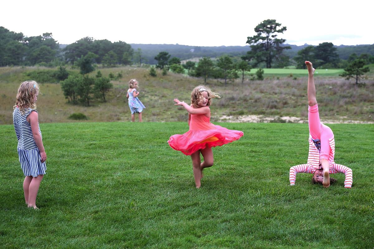 Girls play on the East Hampton Golf Club course.