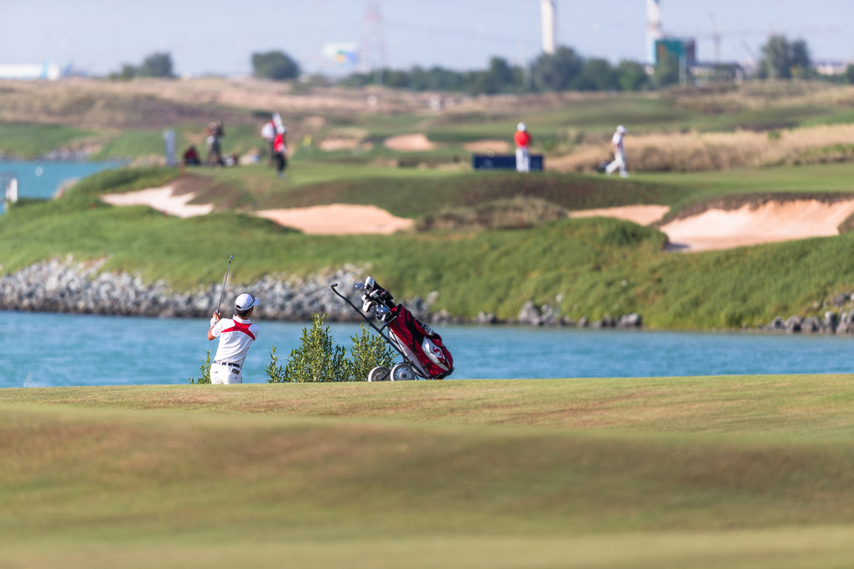 Golfers play at Yas Links in Abu Dhabi.