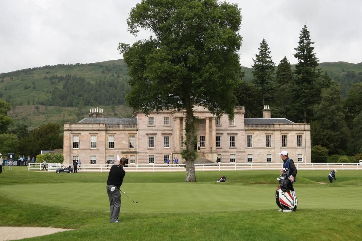 England's Sam Little plays a shot in front of Rossdhu House at Loch Lomond Golf Club