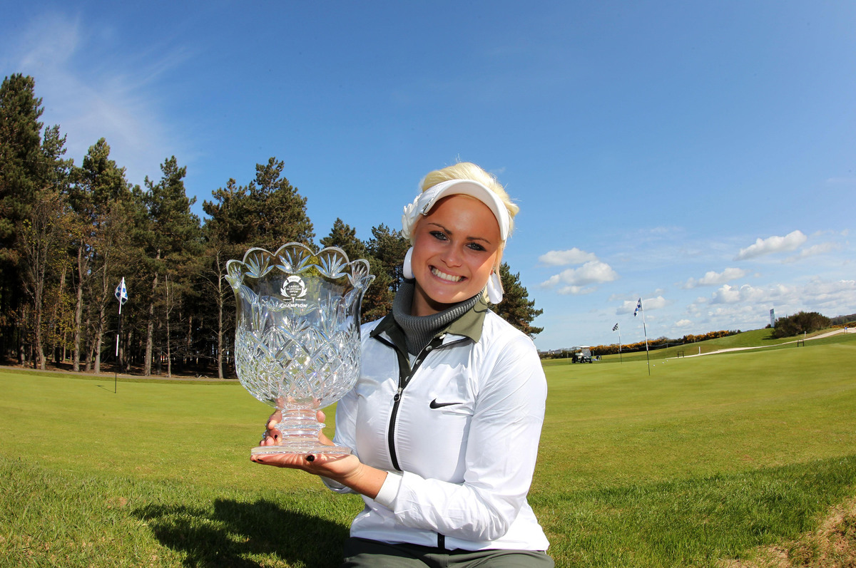 Scotland's Carly Booth celebrates winning the Asset Management Ladies Scottish Open at Archerfield Links Golf Course.