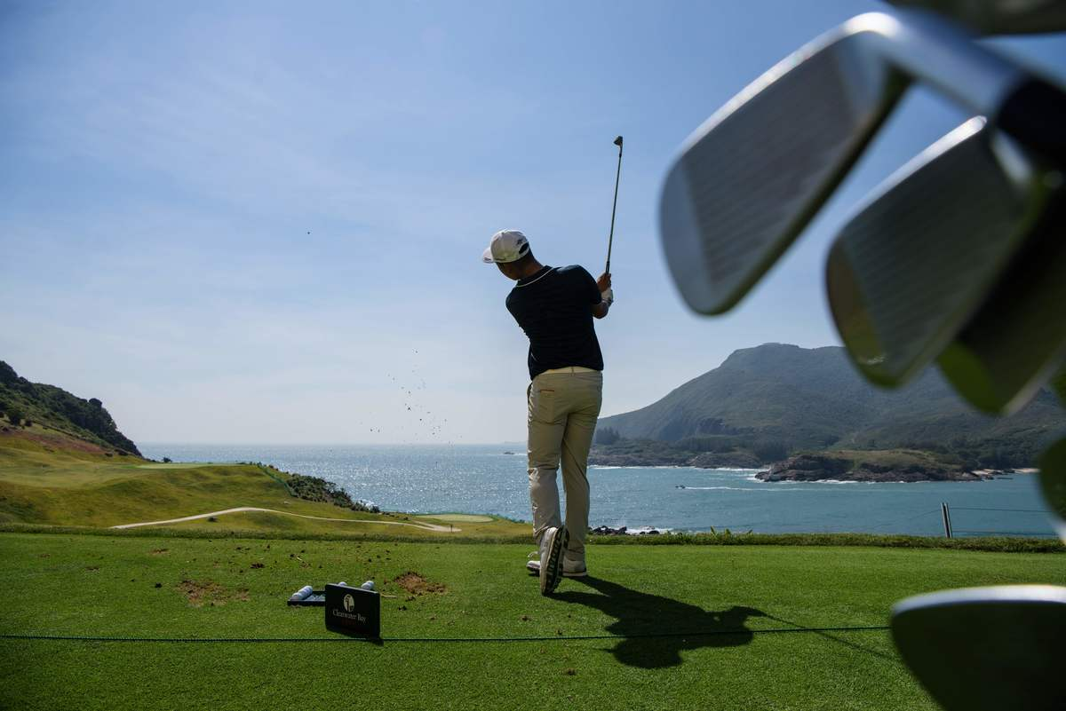 Chinese golfer Lin Yuxin warms up on the driving range prior to teeing off at the first hole at the Clearwater Bay Golf Club in Hong Kong.