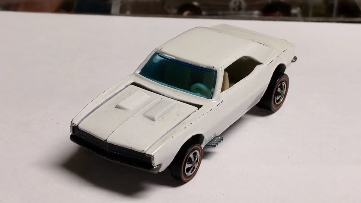 a rare and valuable white custom hot wheel camaro from 1968