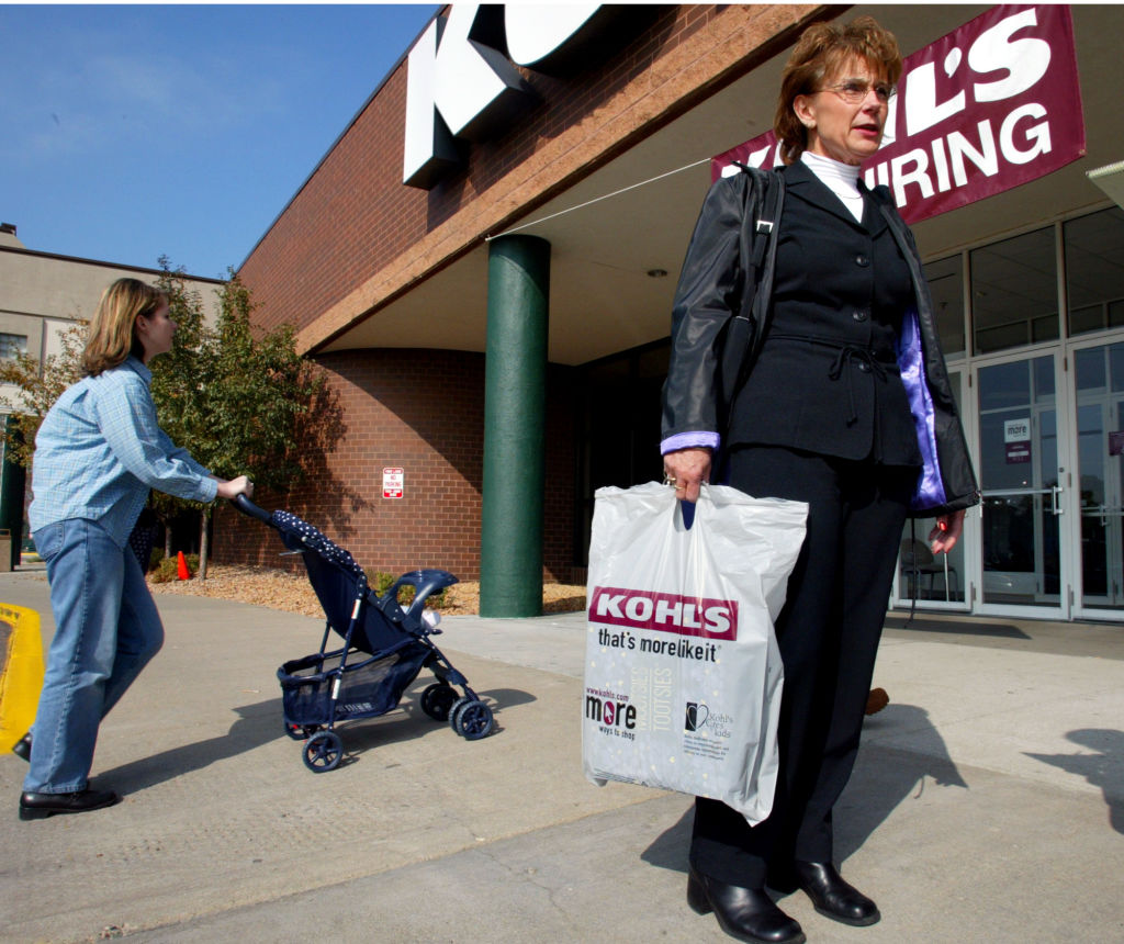 udy Smith of St. Paul, right, gives her views on the current economy outside the Kohl's store