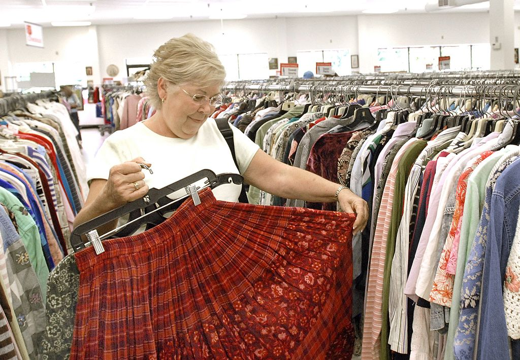 Bev Harvie from Sabattus looks over a skirt at the new Salvation Army