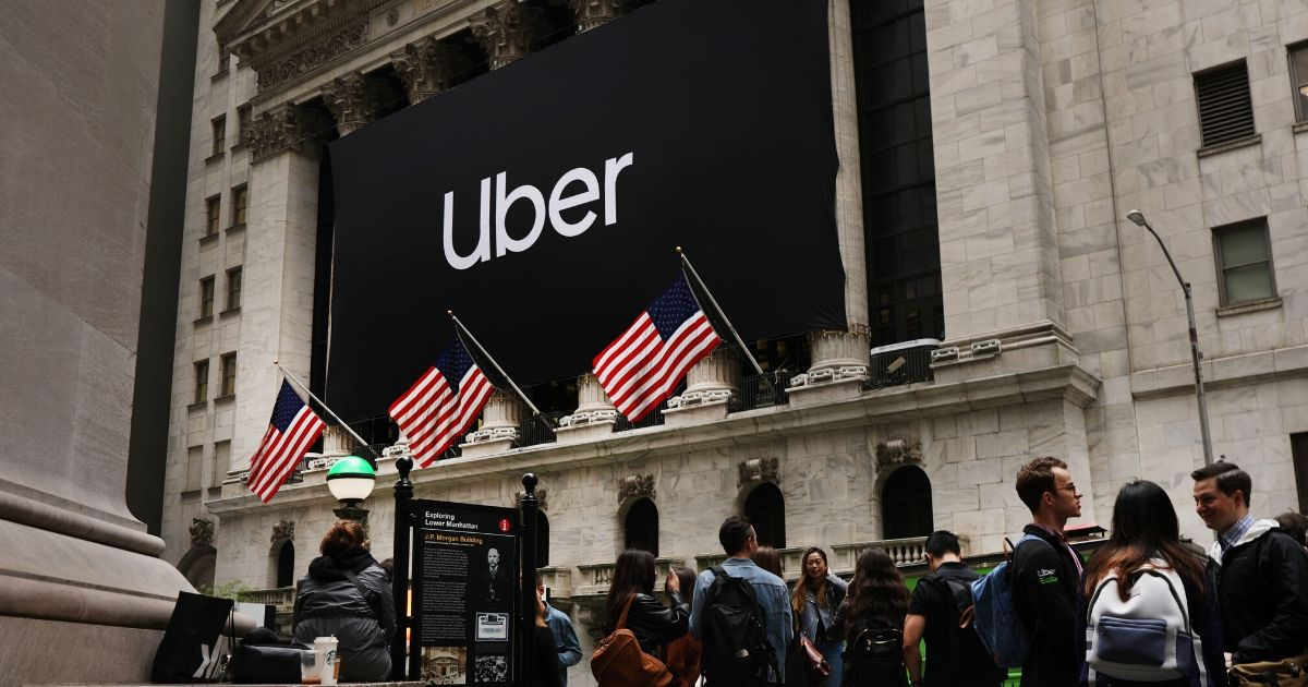 The Uber banner hangs outside of the New York Stock Exchange