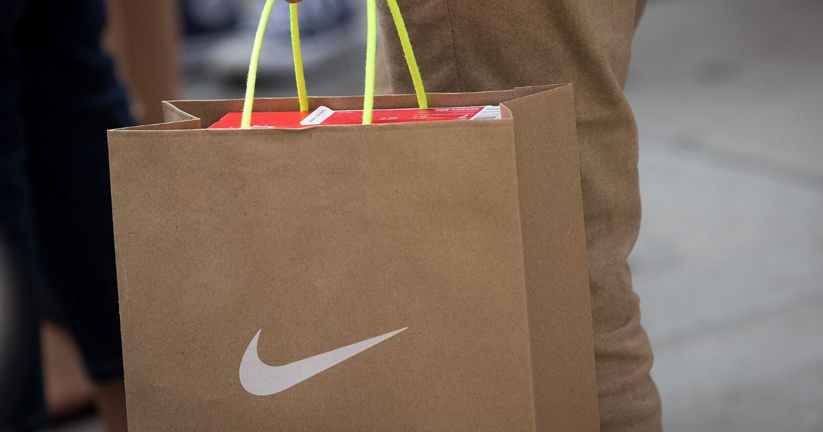 A shopper carries a Nike bag