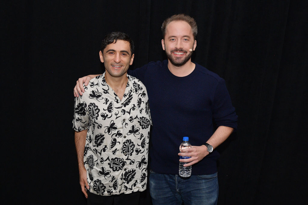 arash ferdowsi and drew houston pose for a photo
