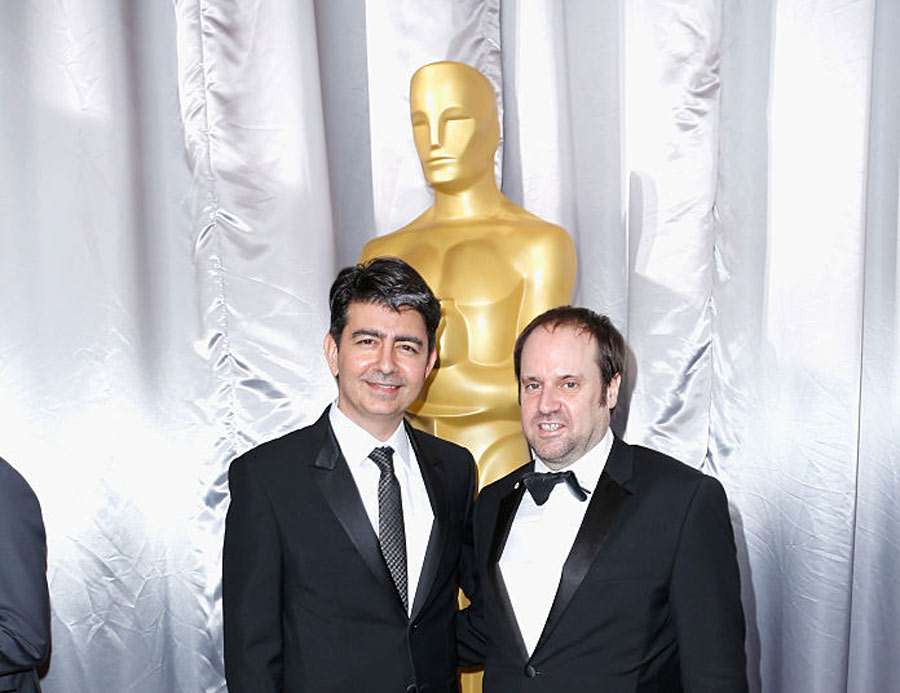 Founder of eBay Pierre Omidyar (L) and producer Jeffrey Skoll attend the 88th Annual Academy Awards