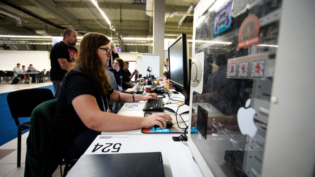 A participant is seen using a computer ahead of the start of the Hackyeah hackathon