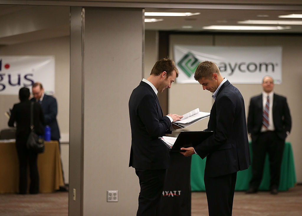 Job seekers prepare to meet with recruiters