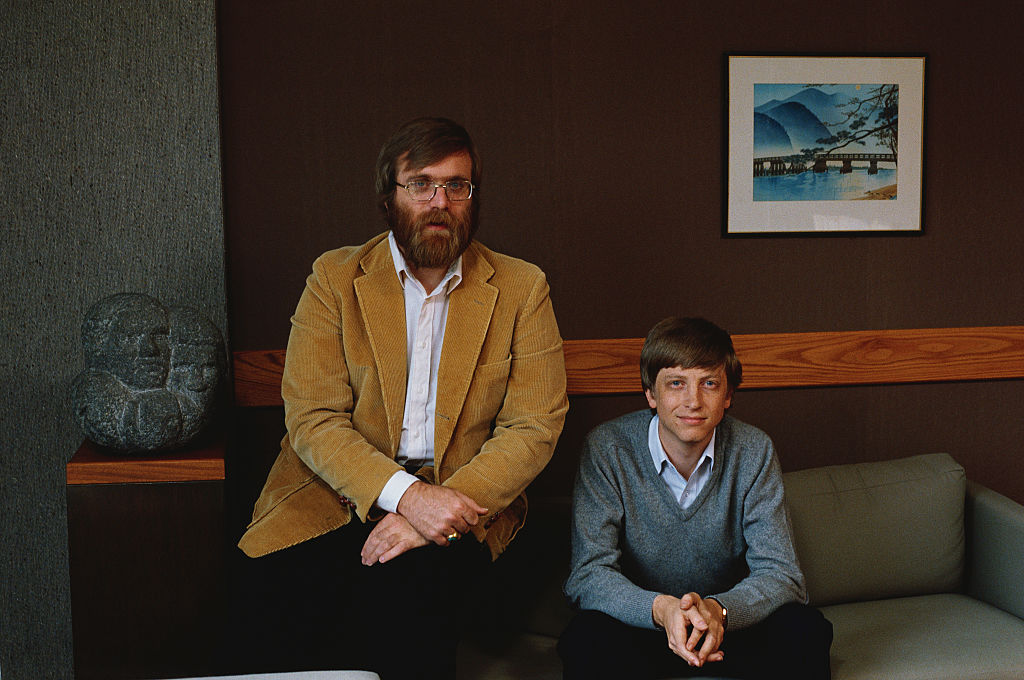 microsoft co-founders paul allen and bill gates posing for a portrait in 1984
