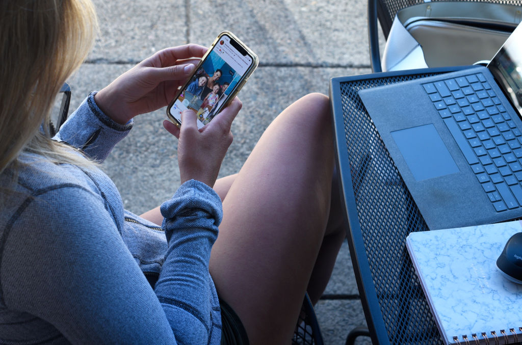 A woman uses her smartphone in Jacksonville, Oregon