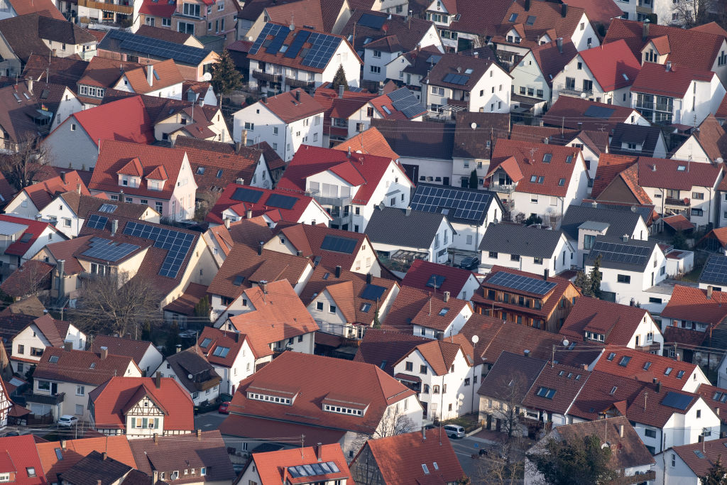 Photovoltaic systems are installed on the roofs of several houses