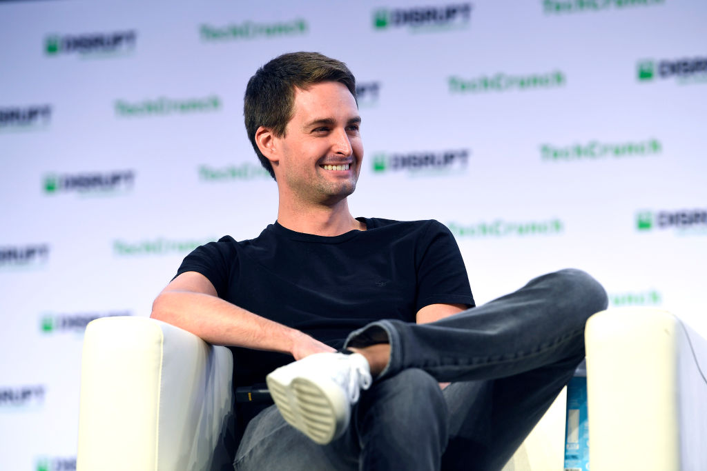 van Spiegel speaks onstage during TechCrunch