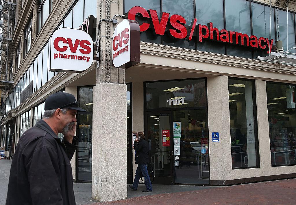 A pedestrian walks by a CVS store