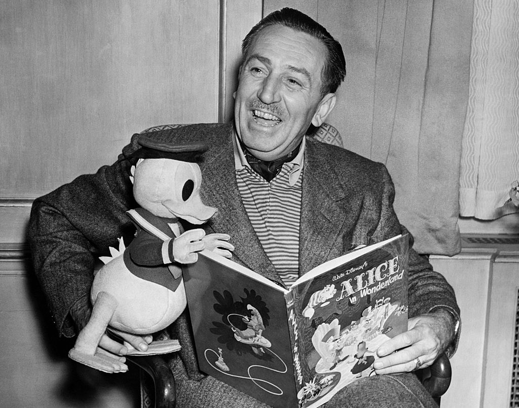 Film producer and cartoonist Walt Disney with a toy Donald Duck