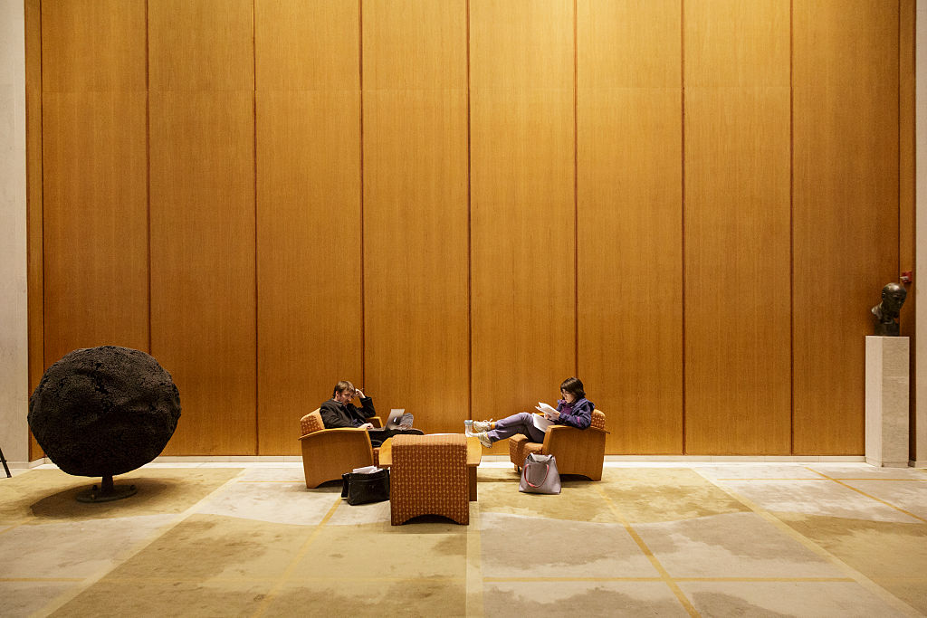 Students lounge in the lobby of the Woodrow Wilson School of Public and International Affairs at Princeton University.