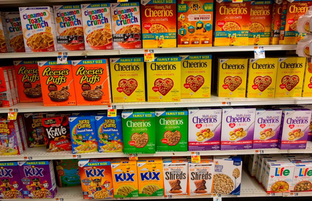 cereal boxes on shelves at a grocery store