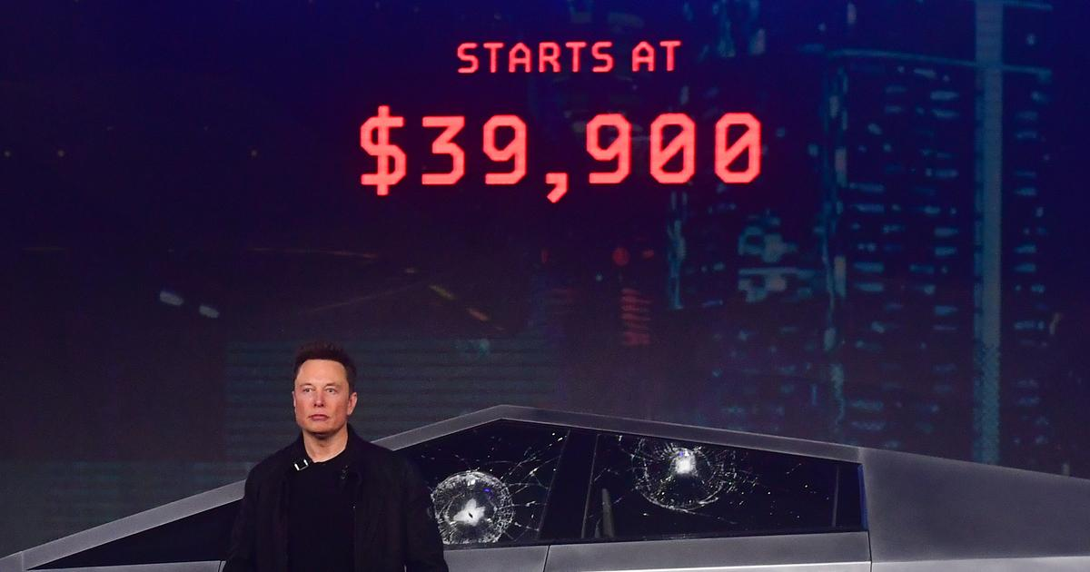 Elon Musk stands in front of the newly unveiled all-electric battery-powered Tesla's Cybertruck