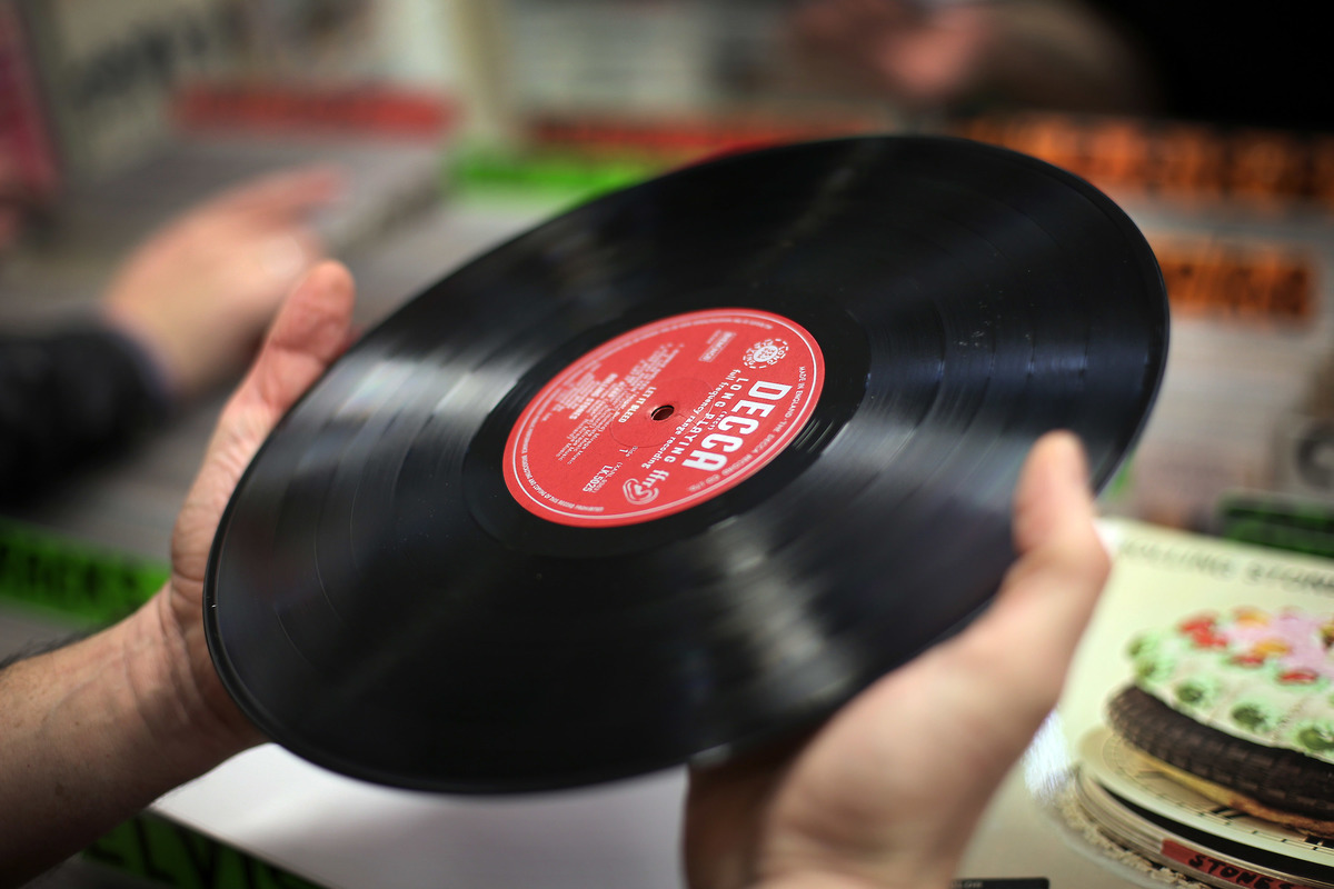 someone holding a vinyl record