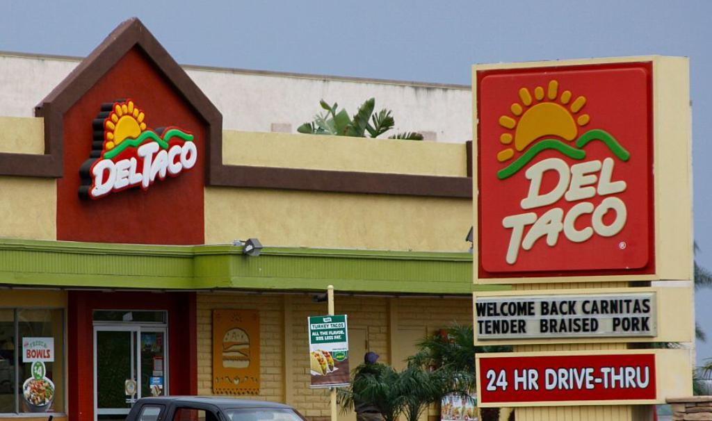 A Del Taco building promotes the return of their carnitas.