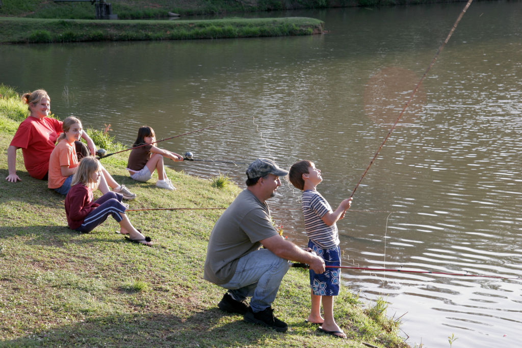 Families fishing in Vanity Fair Lake.
