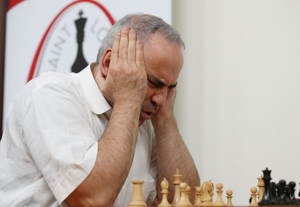 man-holding-his-head-while-he-concentrates
