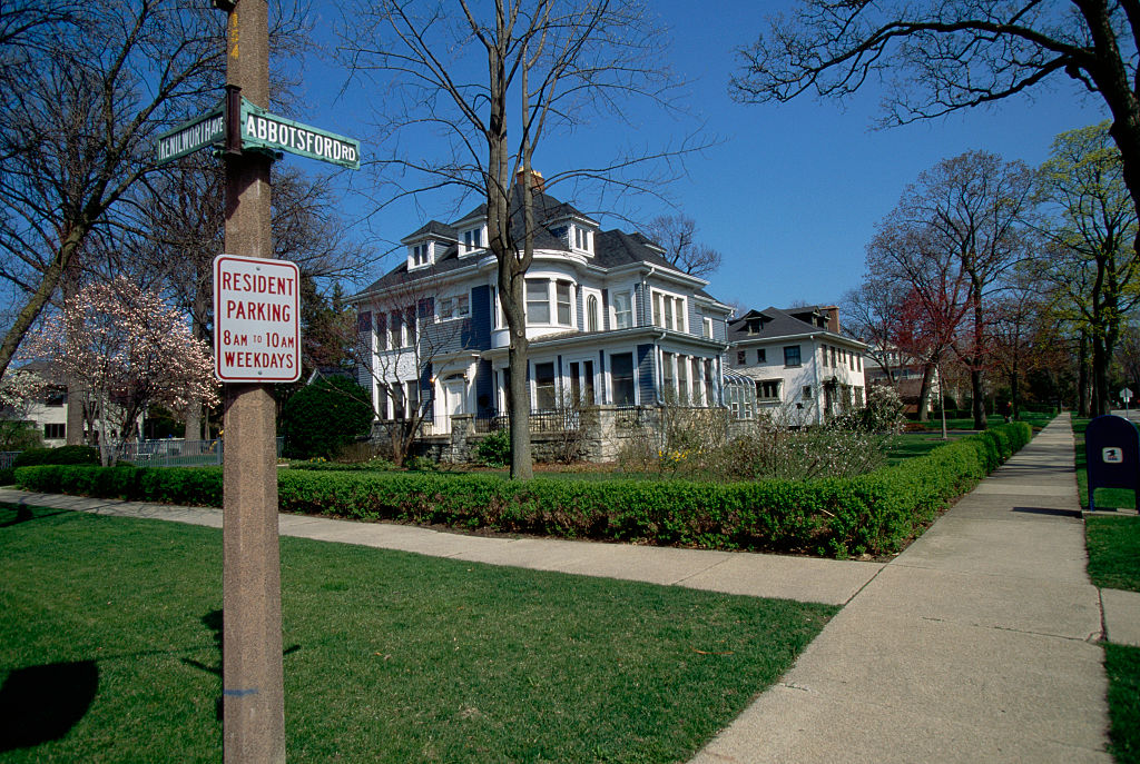 Street signs and a parking sign along an intersection in Kenilworth, Illinois, one of the richest towns in the country.