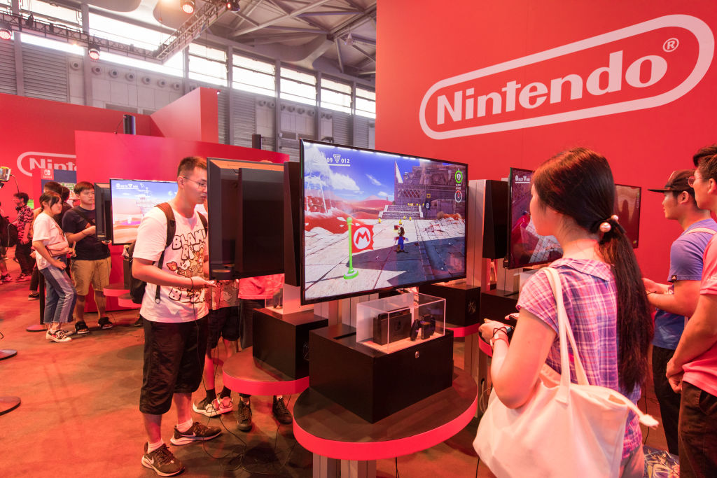People play games at Nintendo booth on day one of the 2019 China Digital Entertainment Expo