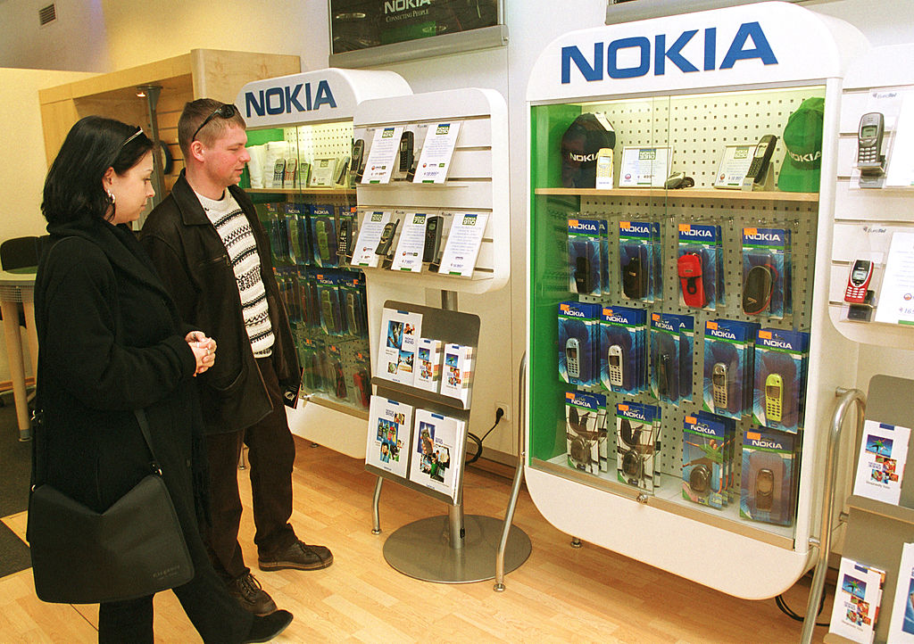 Shoppers check out mobile phone accessories at a Nokia store