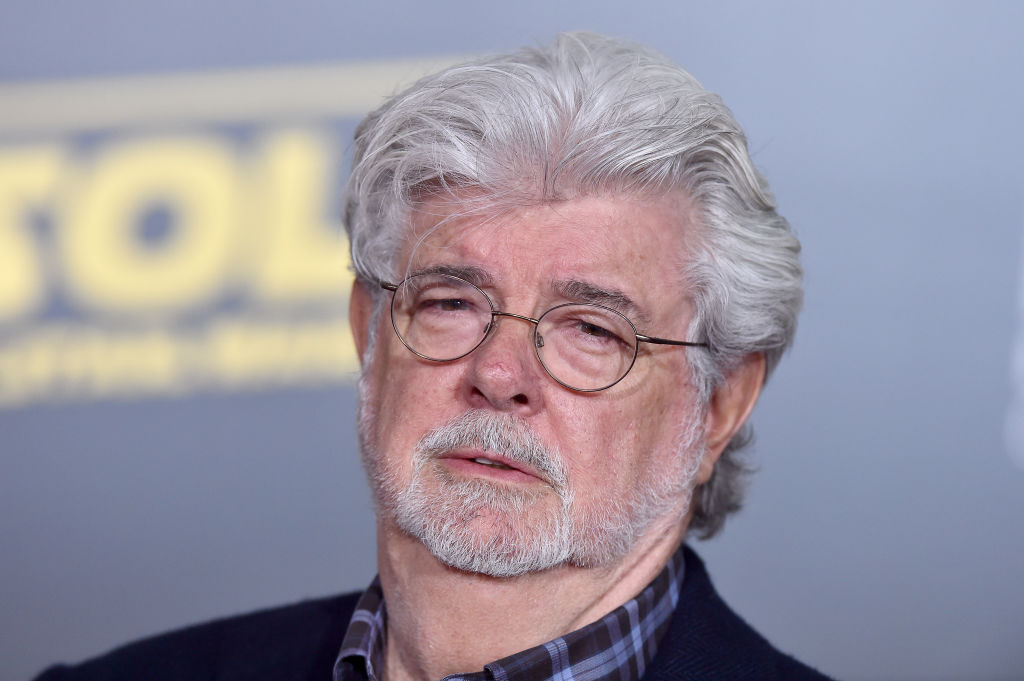 george lucas posing on the red carpet