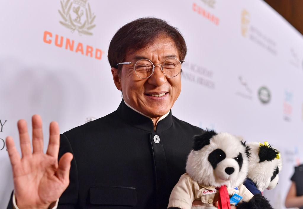 jackie chan waving with stuffed pandas