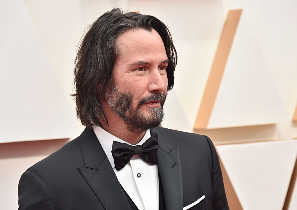 keanu reeves wearing a tuxedo on the red carpet