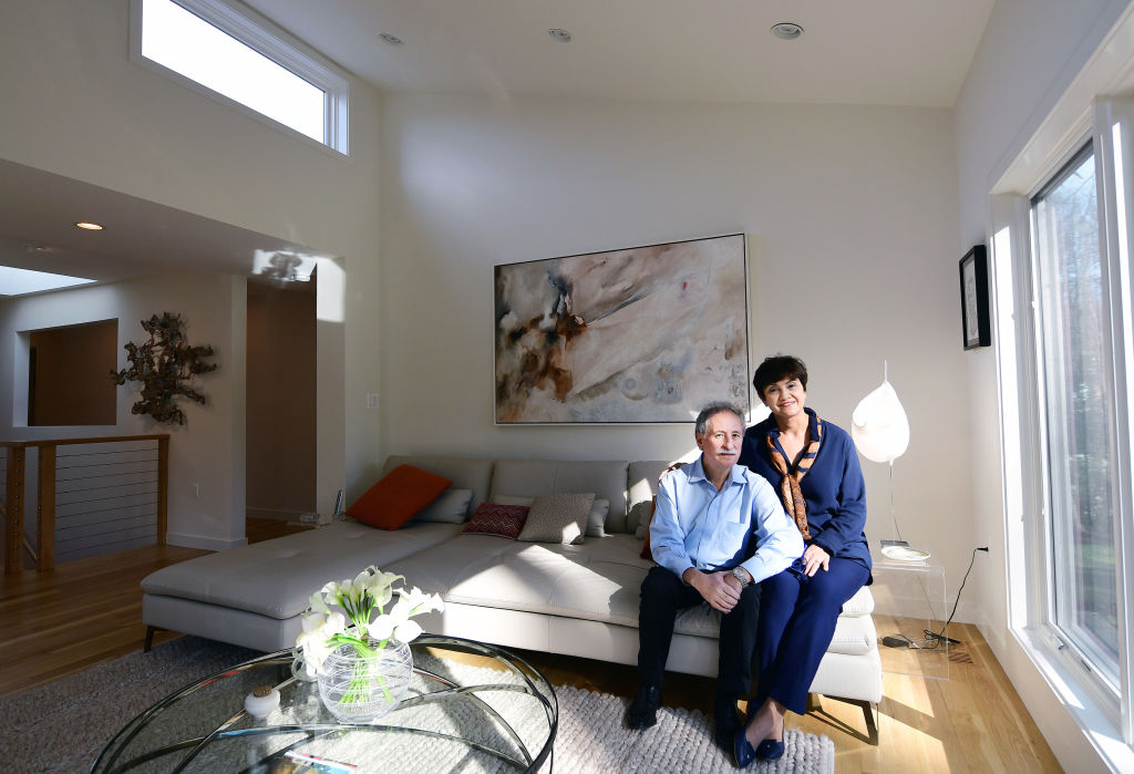 Hector Sierra and his wife, Yvonne Durazzo pose for a portrait at their home