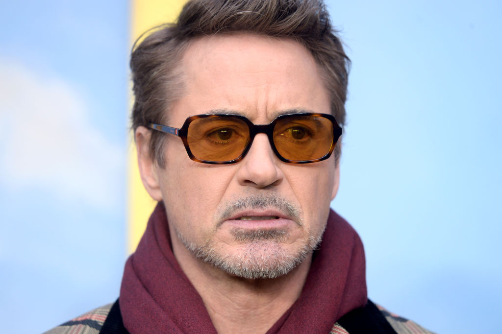 robert downey jr. wearing tinted glasses and a scarf