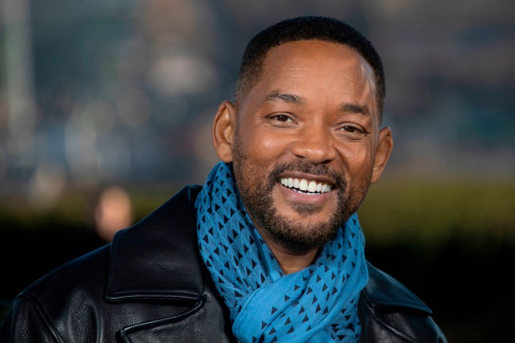 will smith wearing a blue scarf and leather jacket
